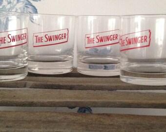 """Set of 4  vintage """"The Swinger"""" rock glasses."""