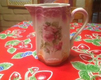 Vintage hand painted ceramic pitcher with rose designs
