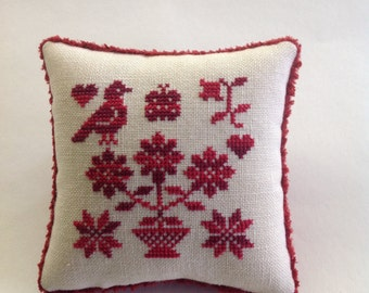 Finished cross stitched red pillow/ bowl filler/ pin cushion.