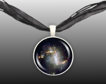 "Topsy Turvy Galaxy NGC 1313 in the Constellation Reticulum Space 1"" Pendant Necklace in Silver Tone or Gold Tone"