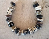 Glass Lampwork Bead set of 19 Rustic Black Cream Taupe Etched with fine silver