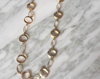 Long brass chain