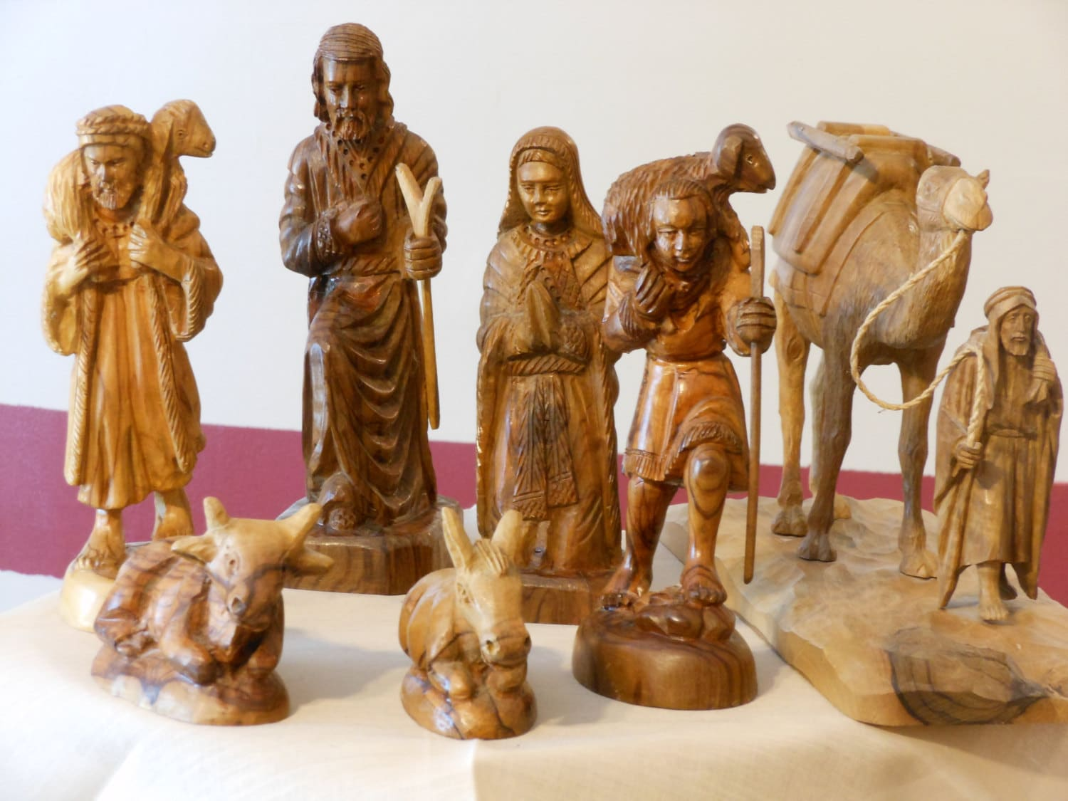 A collection of eight carved olive wood figurines from israel
