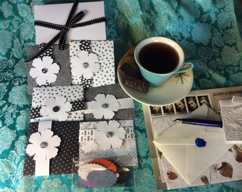 Hand made black and white set of cards, blank with a customizable message.