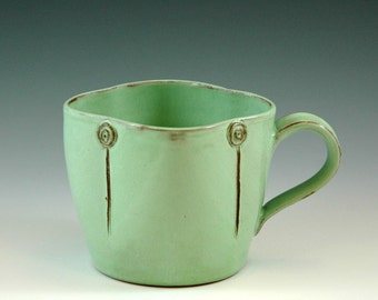 Large mug in pistage green glaze.