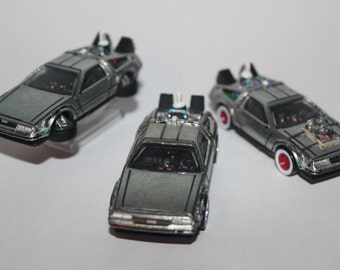 Customized Hot Wheels Back To The Future Deloreans from I, II, III. Retro-Entertainment Line.