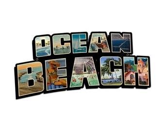 "Ocean Beach laser cut metal sign- Cute beachy theme on metal 28x14""  Perfect for your beach house."