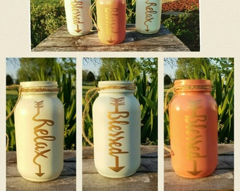 Word arrow relex, family and blessed painted mason jar
