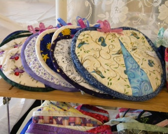 Various-colored potholders that're fun for in your kitchen