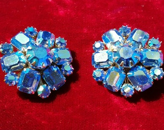 Absolutely gorgeous, 50's, silver tone, Julianna D&E clip earrings with iridescent, bright blue aurora borealis rhinestones by WEISS!