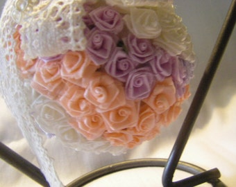 KISSING ball covered in LACE and hundreds of ROSES