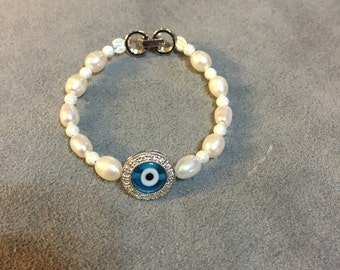 Silver and freah water pearl evil eye bracelet