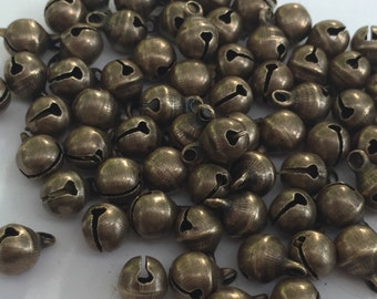 20 Christmas Bells Bronze 6 x 9mm - BD058