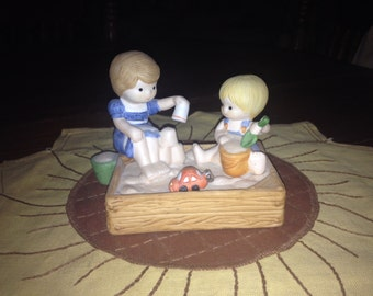 Vintage Enesco Country Cousins In The Sandbox from 1985