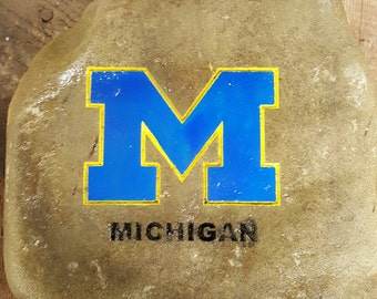 Michigan Garden Stone, college sand blasted out of Pennsylvania stone and then hand painted, weighs about 25 pounds