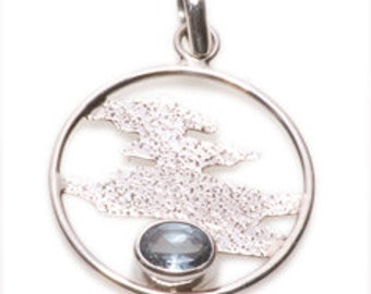 Fine Vintage  Silver Pendant.   Blue Topaz gem and a Silver Chain.