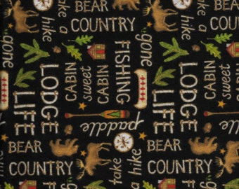 New Lodge Life Word Toss on Black  Flannel Fabric by the yard and half-yard