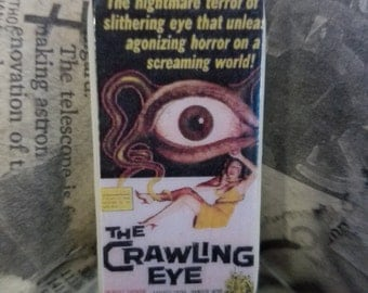 Horror Movie Domino Pendant - The Crawling Eye