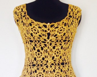 Sparkly 1960's /1970's gold lurex crocheted waistcoat in a UK size medium.