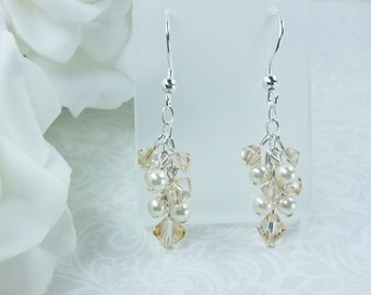 Swarovski pearl and crystal dangle earrings.Cream Swarovski pearls and a choice of Swarovski crystal colours.Matching necklace.