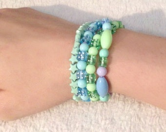 Candy stackable bracelets in pastel blues