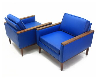 pair of vinyl selig club chairs lounge chairs walnut wood accent cobalt blue