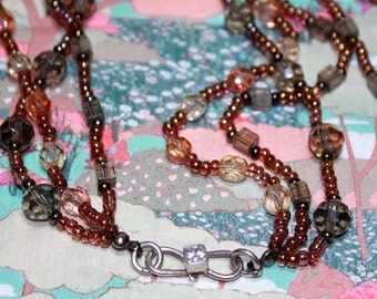 Swarovski crystal and glass beaded multi-strand necklace.
