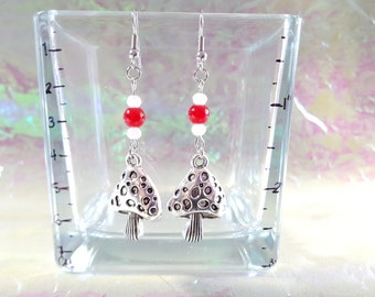 Smurf, mushroom earrings with red and white ball.