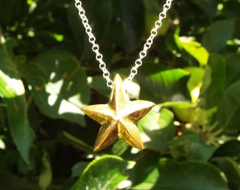Porcelain gold lustered star necklace,  glazed and on a sterling silver 18'' chain
