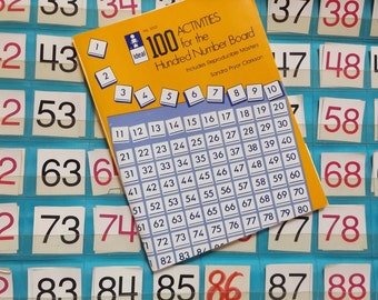 100 Activities for the Hundred Number Board by Sandra Pryor Clarkson Plus Pocket Chart and Math Manipulatives