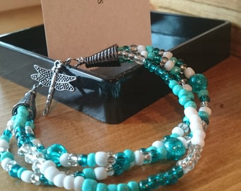 Beachy Teal beaded bracelet with firefly charm