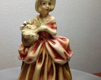 Chalkware figurine of lady with flowers
