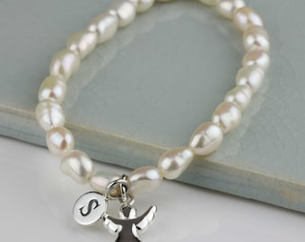 Freshwater Pearl Bracelet with a Solid Silver Guardian Angel Charm Personalised with a Solid Silver Stamped Initial Charm