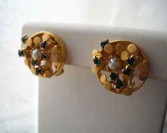 60's French Dull Gold Plated Clip on Earrings; with  emerald rhinestones, one pearl and brass. Abstrat design of a small garden