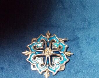 Solid sterling silver Fleur-de-Lis pendant with blue enamel