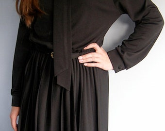 1980s vintage black long-sleeved dress with pleated skirt
