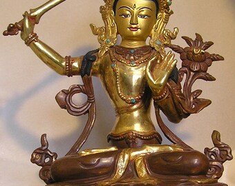 Manjushri Bhodisattva Traditional Tibetan Statue Lost Wax Method, Copper Made, Half Gold Gilded. Gold Face and painted with mineral Paint.