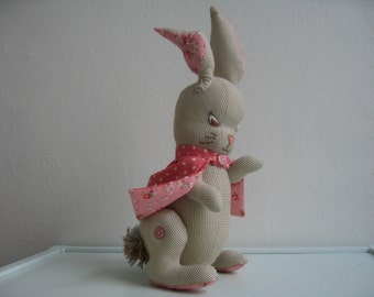 Flopsy: handmade and unique toy with movable arms and legs and a mantle that can be taken off