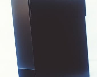 Black modern mailbox made from iron. Very stylish metal mail box with lock. Durable postbox in black colour
