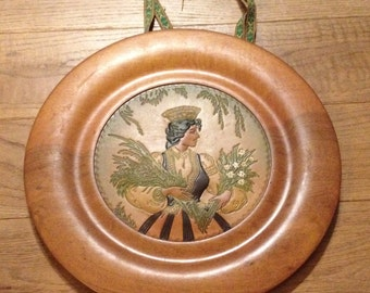 Unusual Wooden Plate With Leather Imprinted / Embossed Scene Of A Woman Holding Flowers.
