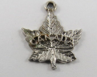 A Maple Leaf with Canada Engraved in Center Silver Charm of Pendant.