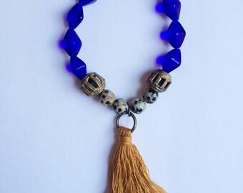 cobalt bracelet with mustard tassel