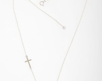 Sterling silver paisley necklace with cross.
