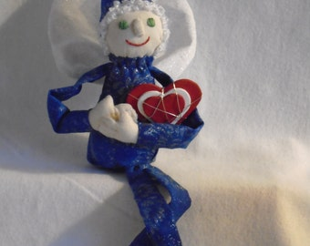 Winter Fairy with snowflakes and a heart