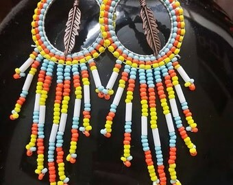 circular feather beaded earrings