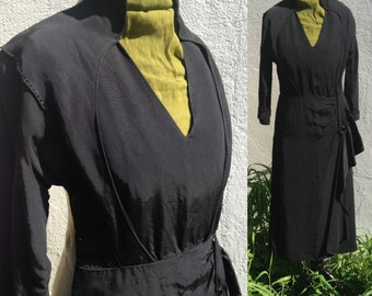 Vintage 1950s dress with beading and sculptured gathered detail at hip