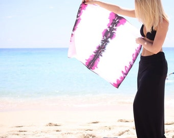 This multifunctional wrap is sure to become your favorite - Black, White and Pink