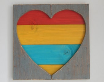 Colorful heart on wooden pallets