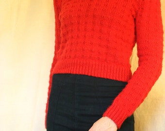 Beautiful hand knit red wool sweater