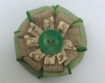 Beautiful hessian ribbon brooch .
